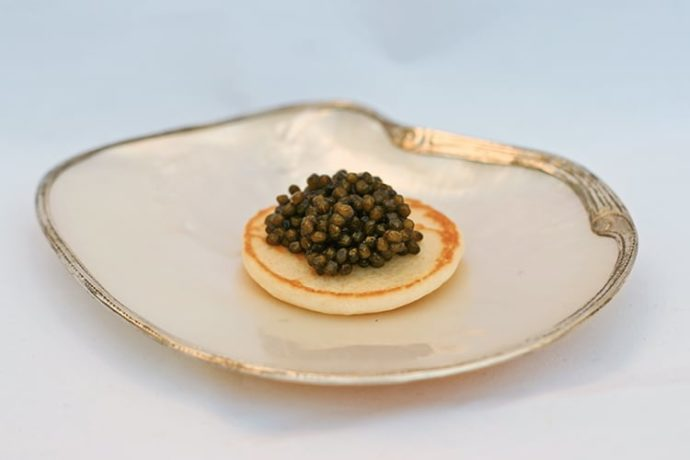 mini blinis with caviar on top
